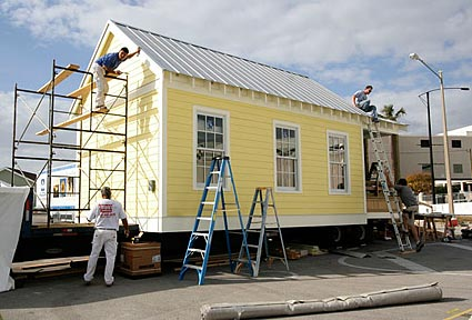 construction crew puts finishing touches on katrina cottage 1 photos by sandy sorlien